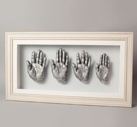 Framed hand Casts of a family of four.