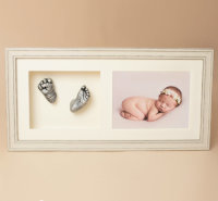 Baby casts in cream frame with photo