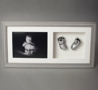 Grey framed baby prints