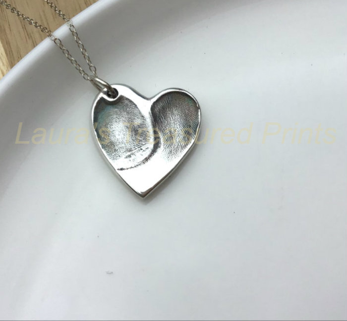 Foundry cast double fingerprint pendant