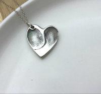 Foundry cast double fingerprint pendant