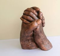A couples hand cast finished in copper.