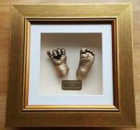Gold 3D Hand and foot casts in a gold frame