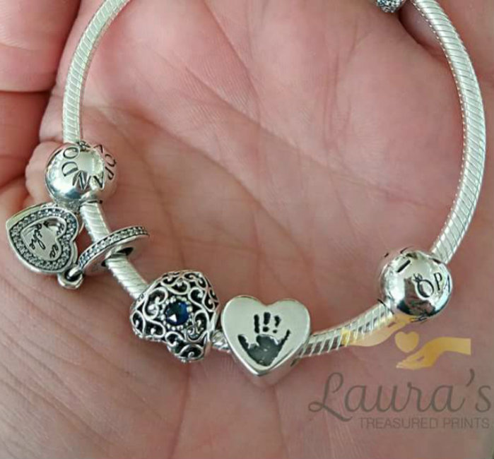 Handprint bead on bracelet