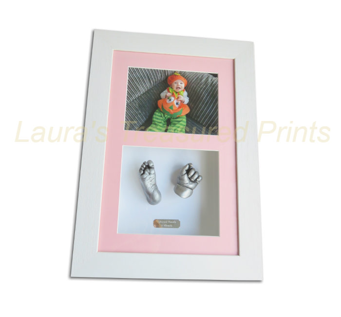 Silver effect 3D baby casts in a white frame with photo