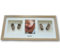3d baby casts in a copper effect in an oak frame.with photo
