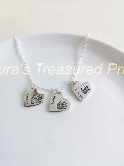 Heart hand- print pendants