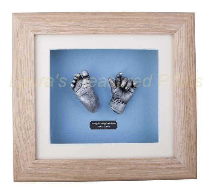 3D hand & foot newborn baby cast in solid oak frame.