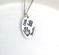 Oval silver handprint pendant