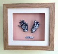 3D Baby Casts in a solid oak frame with pink backing board