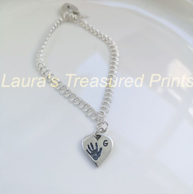 Looped heart silver charm