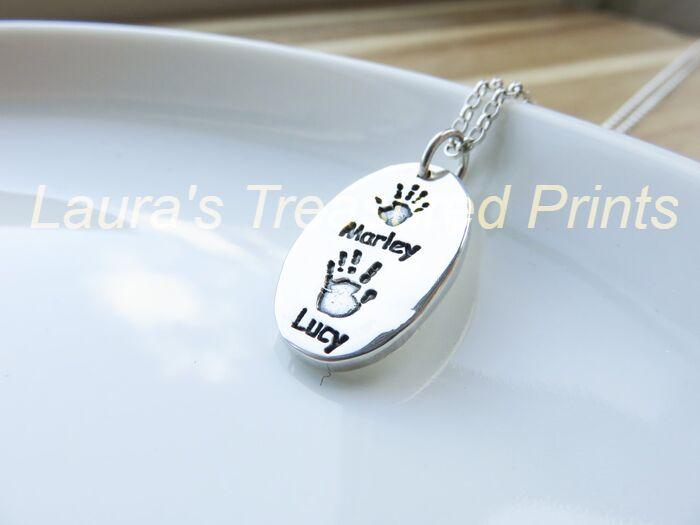 Foundry cast oval hand print pendant