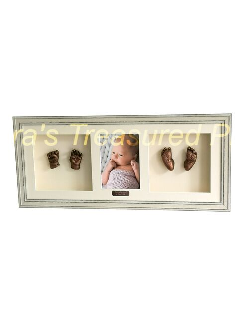 Full set of 3D baby casts in an oak frame.with photo