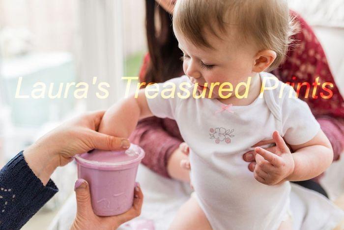 Baby having hand cast taken