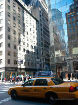 New York - reflections and yellow cab on 5th Avenue