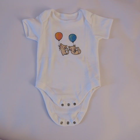 Embroidered baby grow with playful kittens