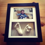 Framed hand and foot cast with photo - £85