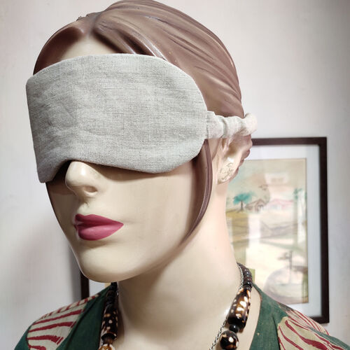 Brown Linen eye mask on a mannequin