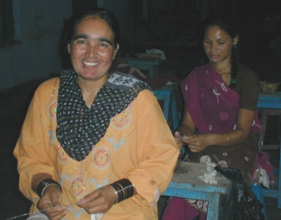Meena spinning silk in Little Flower