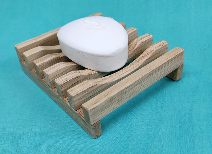 Wooden soap stand with a bar of white soap