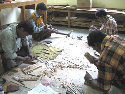Tarak Nath Roy and Wood Carvers from Helen Keller Group in MESH Design Studio