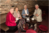 Eunice Clark, Brenda Arnold, Henny Castleton & Gerry Arnold enjoying a cup of coffee before the meeting starts