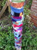 Yarn- bombed tree