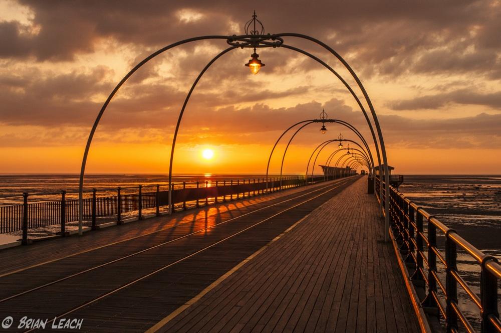 Sun Setting Over The Pier