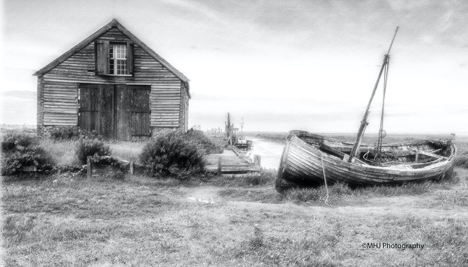 BW Old boat hut and boat