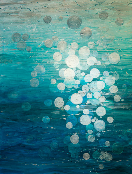 As the bubbles fly up they reflect all the colours around them