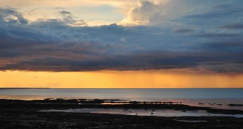 L1019 Seahouses Rain at Sunset