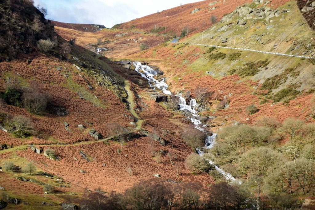 Water cascading down a hillside in Wales