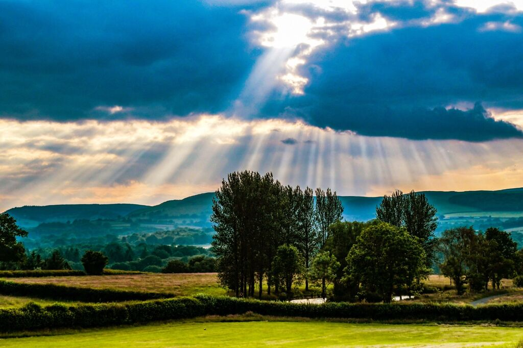 A crepuscular sky across Mid Wales July 2021