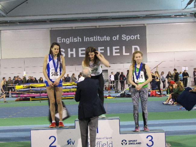 Hannah collecting  medal