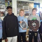 The Corp match trophies - Imogen, Denzel, Olivia (holding under 15 trophy), Ollie holding under 17 men trophy (Beth Goymour race to follow)