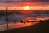 Sun, Turbines, Groyne and Sea