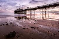Under Cromer Pier at Dawn