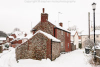 Flint cottage in Snow