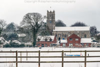 Ormesby St Margaret Church in snow