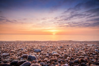 Sunshine on the pebbles at Hemsby