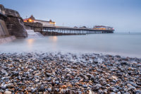 Dawn over the pier on Cromer Beach