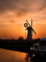 Sun behind mill at Thurne