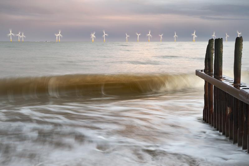 Turbines at dusk by a Groyne