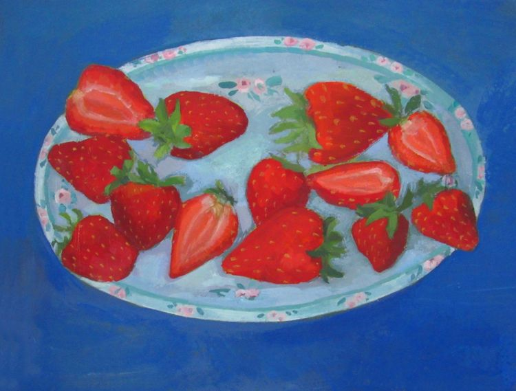 Strawberries on a blue plate