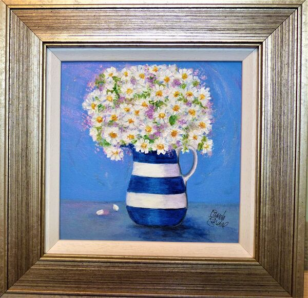 Daisies in striped jug