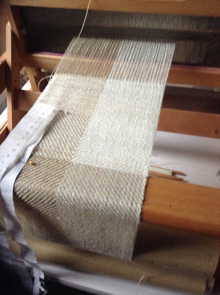 4 shaft table loom threaded with linen