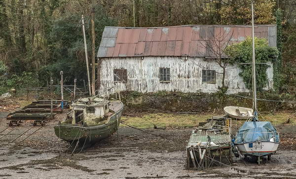 Old boat shed and boats