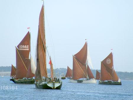 Thames sailing barges jostle for position.