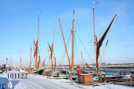 Sailing barges in the snow