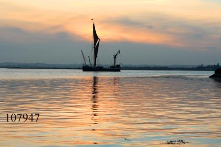 Sailing barge at twilight